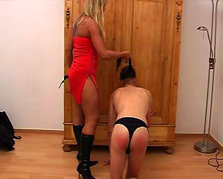 Mistress in boots spanking femdom slave