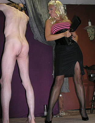 Fishnet stocking mistress torturing femdom slave